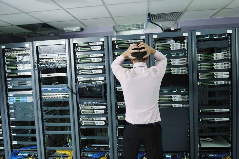 Disaster Recovery and RTO: Business owner is stressed about system failure in a server room.
